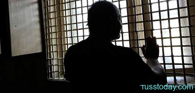 Заключенный в тюремной камере
